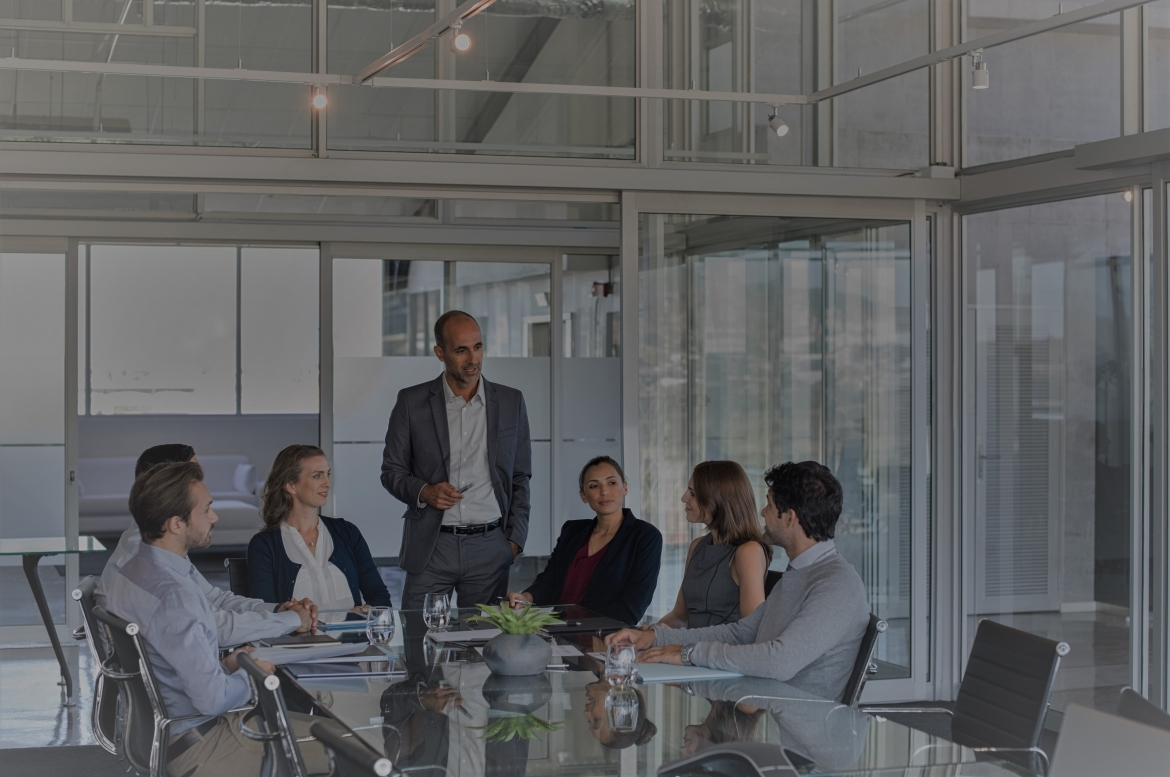 business-team-in-a-meeting-PW9SY6F-1-Natural-Warmth-1.jpg