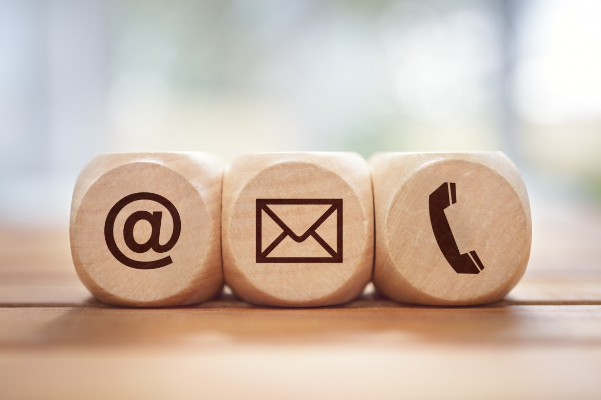 contact-us-concept-with-wood-block-and-symbols.jpg
