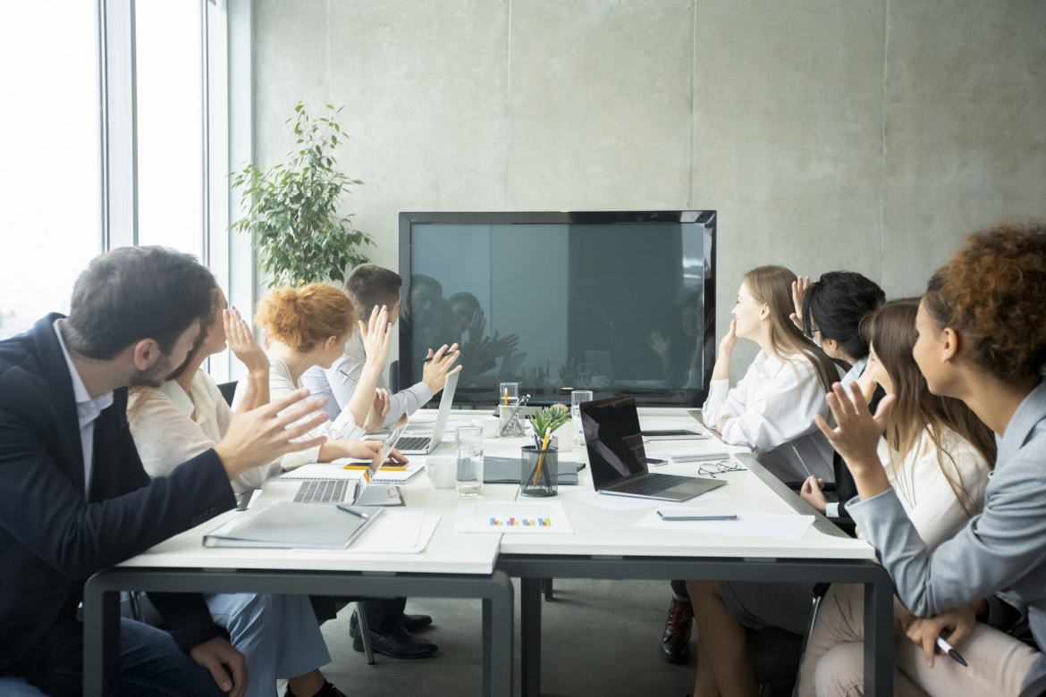 videoconference-businesspeople-greeting-boss-waving-hands-to-screen.jpg