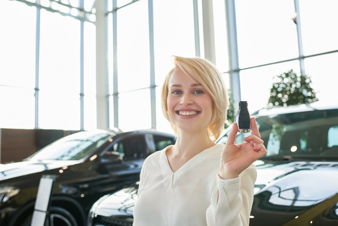 attractive-young-owner-of-new-car.jpg