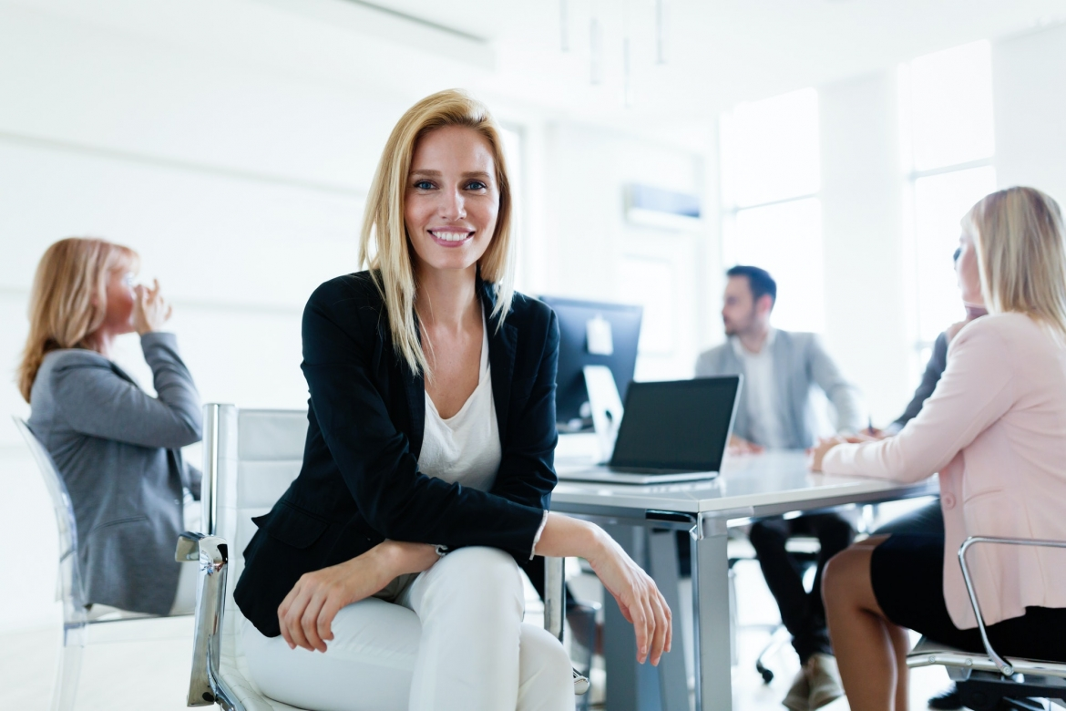 picture-of-attractive-saleswoman-on-meeting-in-office.jpg