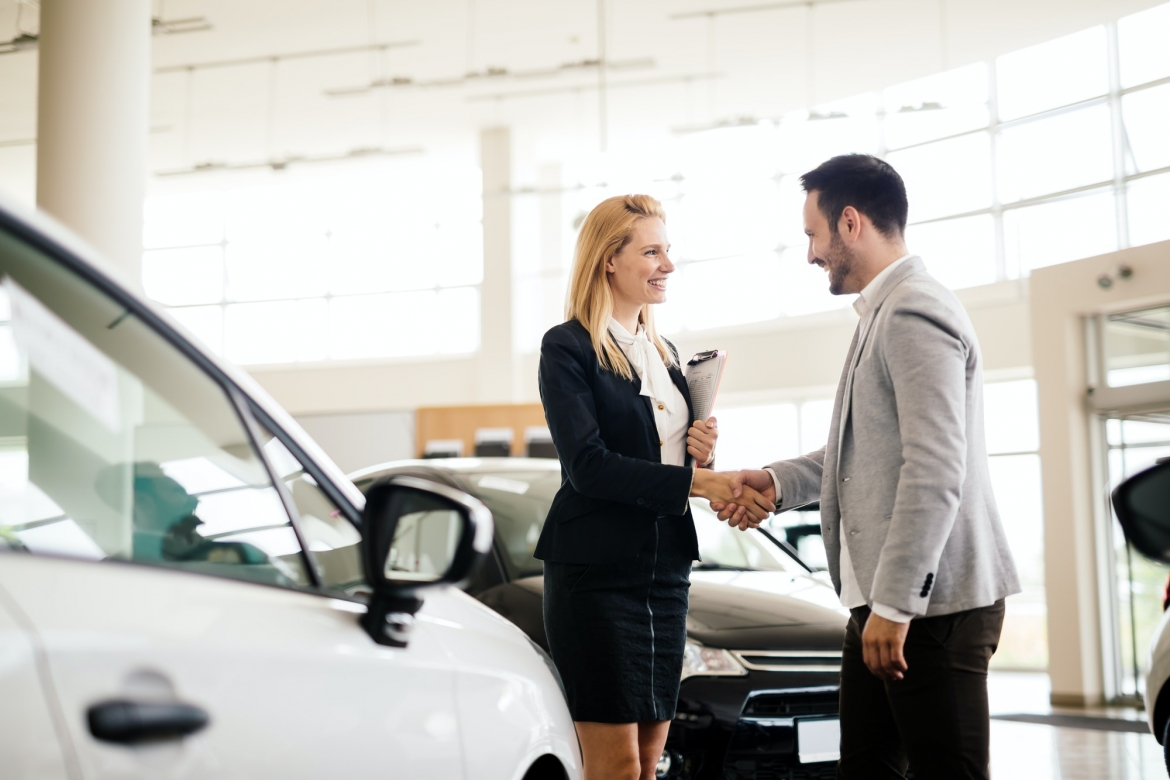 salesperson-showing-vehicle-to-potential-customer.jpg