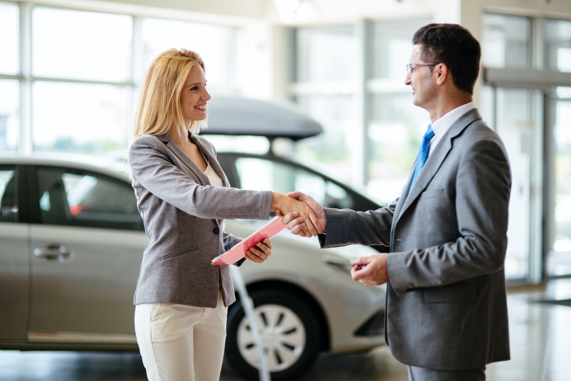 successful-businessman-in-a-car-dealership-sale-of-vehicles-to-customers.jpg
