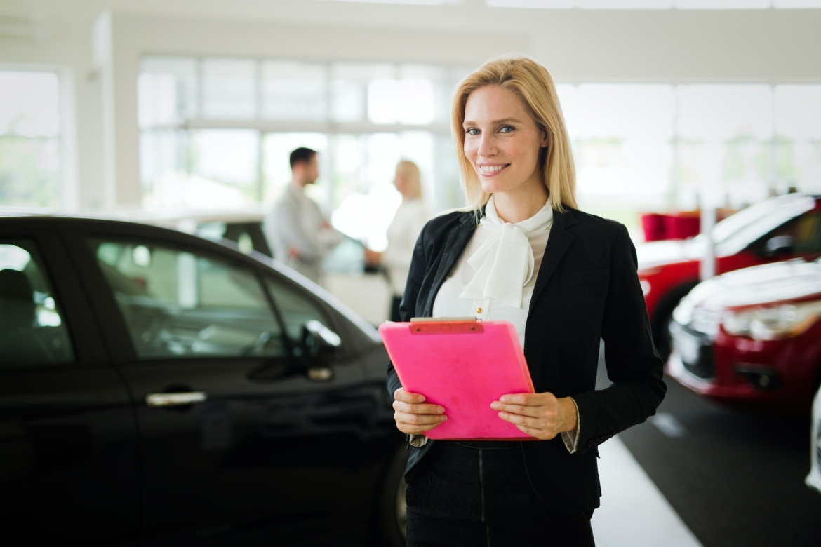 young-female-car-sales-consultant-working-in-showroom.jpg