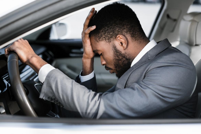 stressed-businessman-feeling-headache-in-car-stop-the-car.jpg